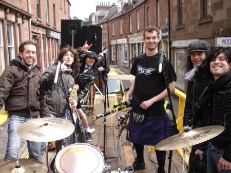 "Buon Scotch recreating ""Long Way To The Top"" in Kirriemuir Town Square"