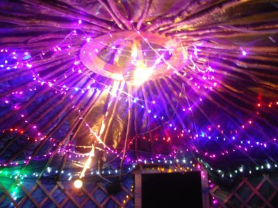 Stevie C setting up an outdoor party/rave yurt with LED and Disco lighting