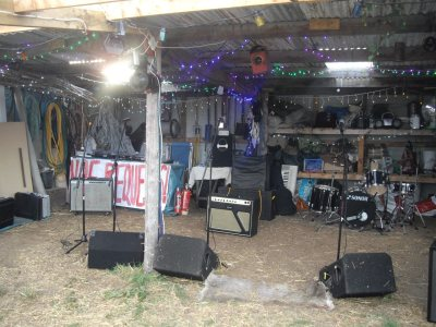 Stevie C setting up a PA system, LED stage lighting and disco lighting for an outdoor party/rave