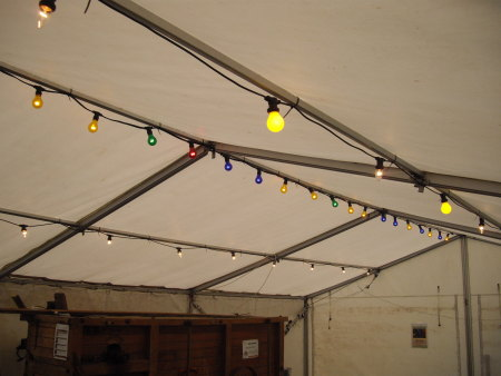 Stevie C providing marquee festoon lighting for an outdoor event at Barry Mill, The National Trust Scotland.