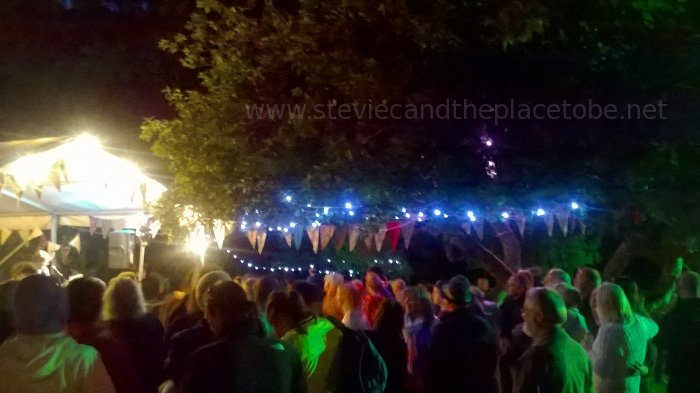 Music at Barry Mill. LED and Festoon Lights by Stevie C. Outside in the grounds with the crowd around the Apple Tree.