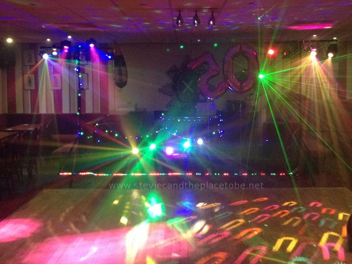 DJ Ross playing at the Black Watch function suite Dundee with disco lighting supplied by Stevie C