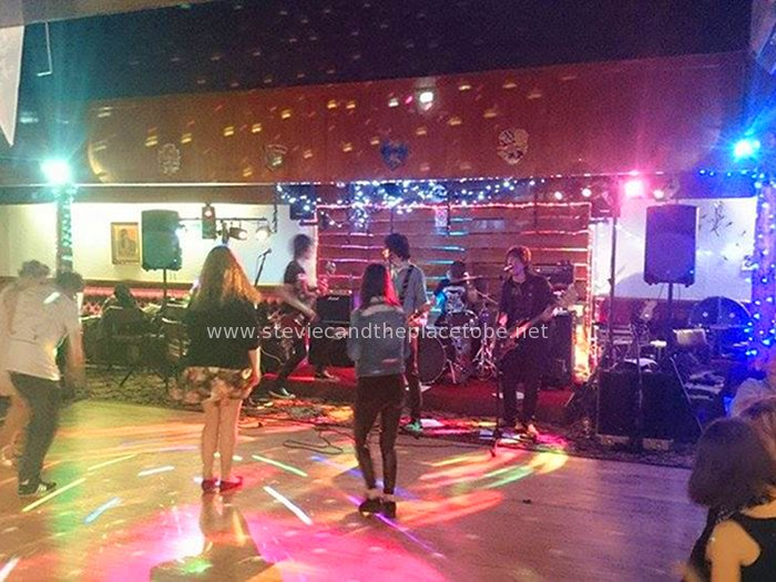 Stevie C doing disco lights and music at the Kirriemuir Thistle Social Club bar/function suite. The band was Around 7.