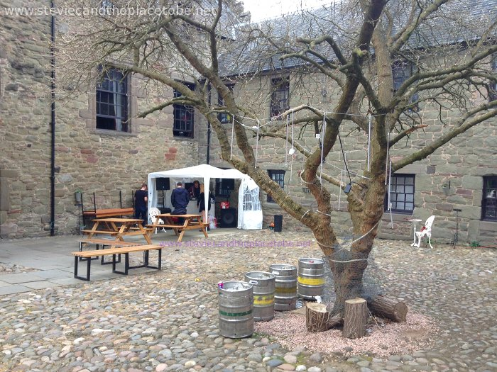 Mains Castle Dundee Courtyard by day: Stevie turns up to find audioWAVE setting up for Roots and some fairy lights on the tree