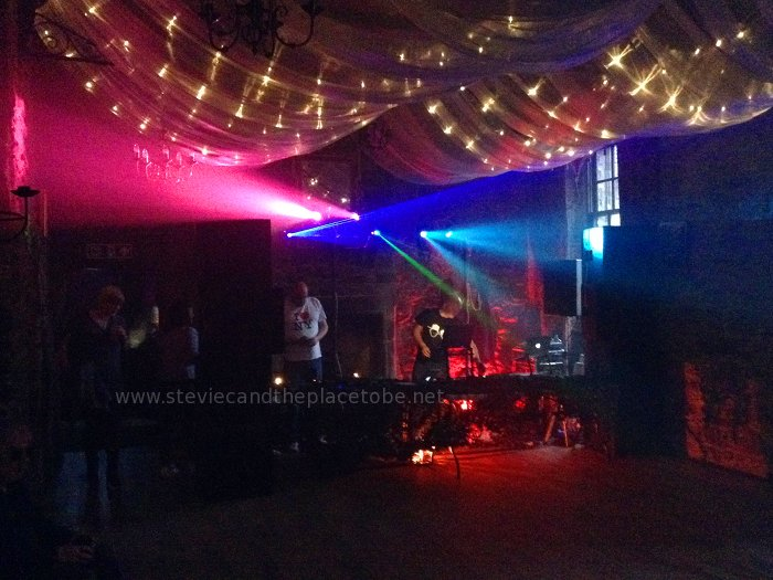 Mains Castle Dundee inside function suite: disco lights for Roots, with red uplighting for mood and disco scanners