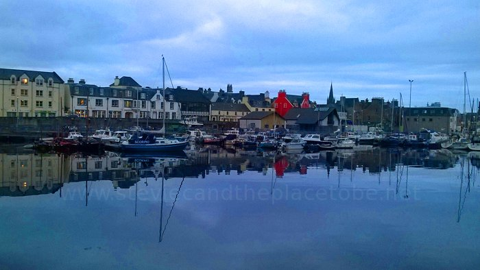 Stornoway, Isle of Lewis. Bayhead, Boats in Bay. Houses and buildings in reflection.