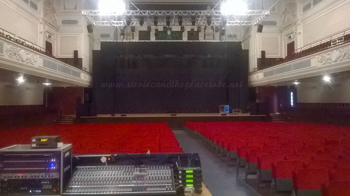 Stevie C crewing for audioWAVE sound hire in Caird Hall Dundee installing D&B speakers for comedian Frankie Boyle.