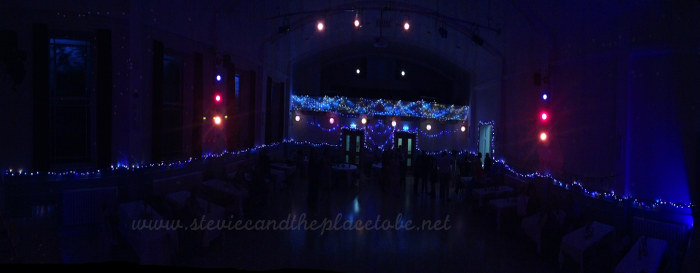 Stevie C Wedding Reception lights at Kirriemuir Town Hall: panoramic photo of Chinese paper lanterns, stage spotlights, LED fairy lights
