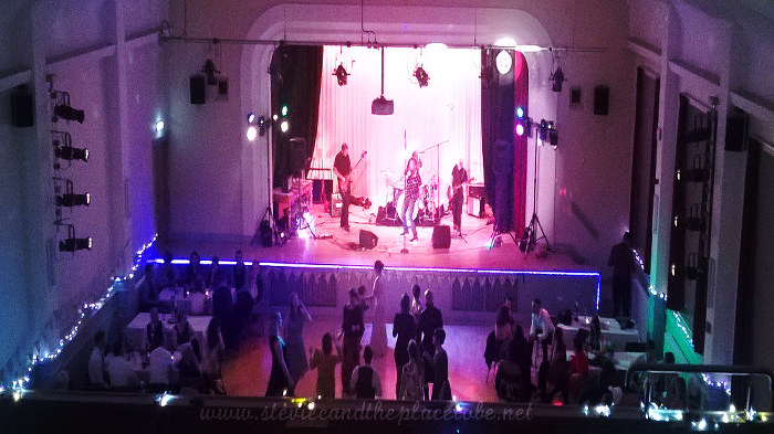 Stevie C Wedding Reception lights at Kirriemuir Town Hall: LED tape light, follow-spot lighting a mirror ball, Restless Natives onstage