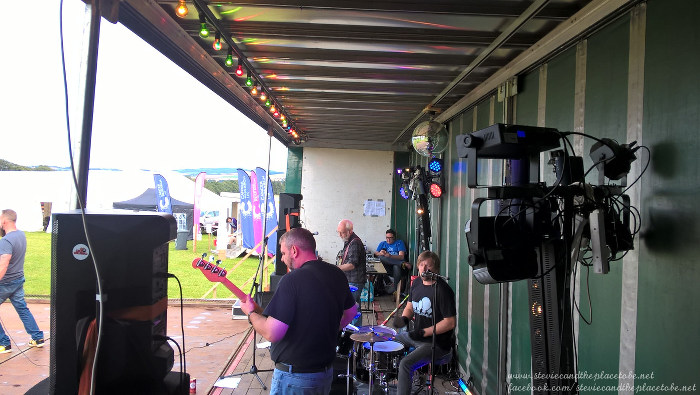 DD8 Music at Cancer Research UK Relay For Life Kirriemuir. Restless Natives band onstage, festoons & light show provided by Stevie C.