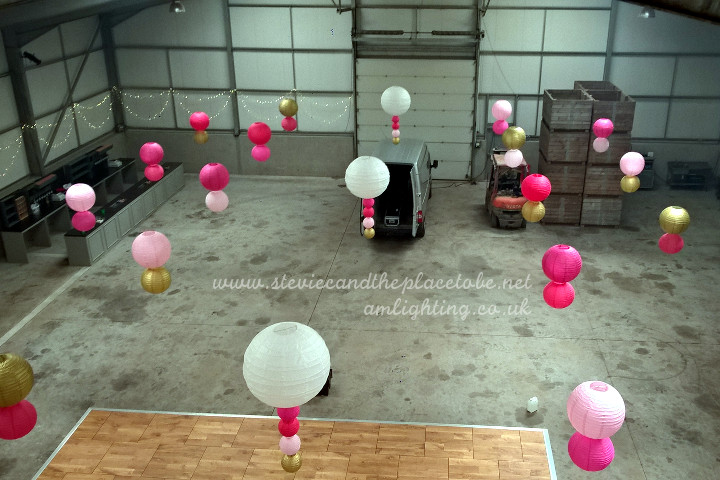Setting up a wedding function disco in a cow shed with AM Lighting LTD; Auckland Oak wooden dance floor, band/stage lighting and fairy light canopies supplied.