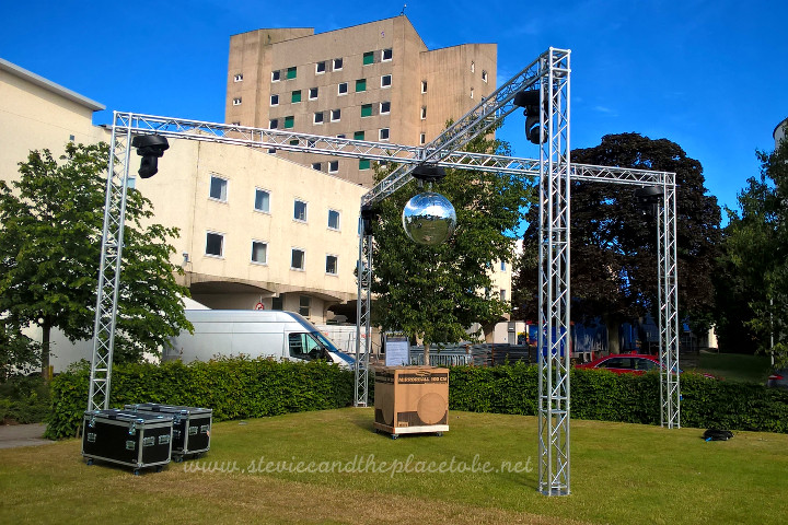 DUSA Dundee Grad Ball setup with AM Lighting Ltd - gigantic 1M mirror ball installed in courtyard with 4 moving-head lights