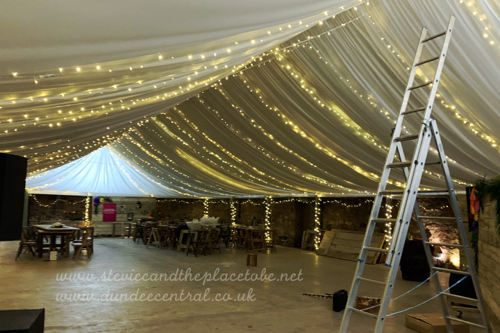 working for Steve Page Lighting installing LED festoons and fairy light canopy for a wedding venue in Fife