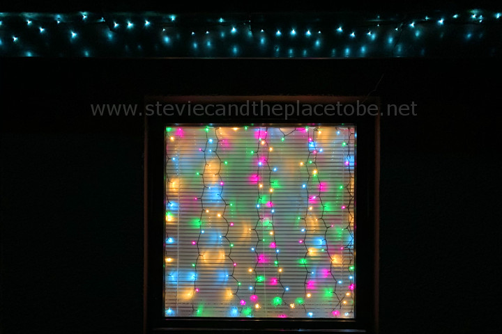 LED xmas fairy lights in my window and on my roof