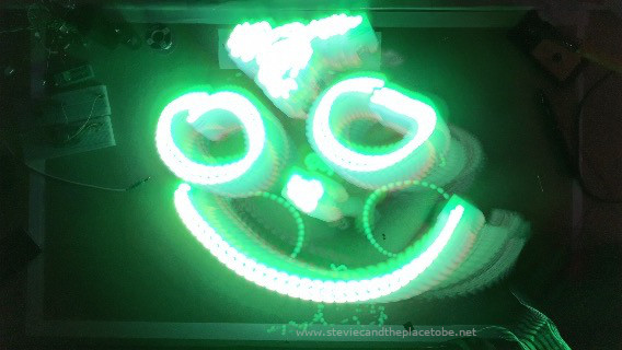 Artistic light painting using a Slow Shutter app to produce LED light trails in the shape of a smiley face