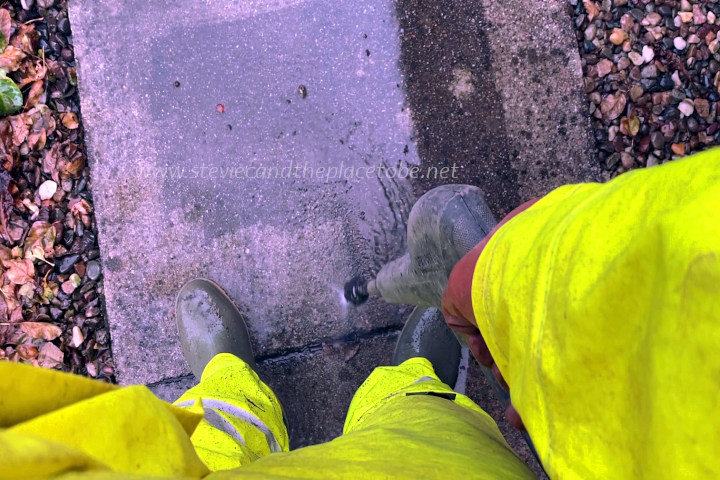 Pressure washing a driveway in my B-Dri waterproof overalls and dunlop wellies.